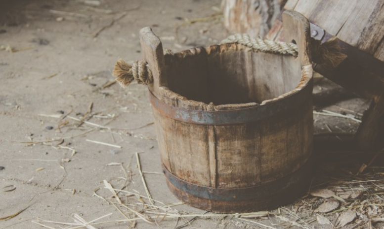 escape room puzzle: old bucket in a barn